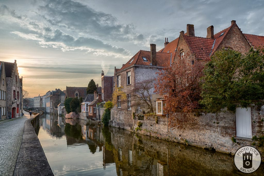 The sky lights up a row of lovely canals and reflections in Bruges Belgium. Photo by Photo Tour Brugge.