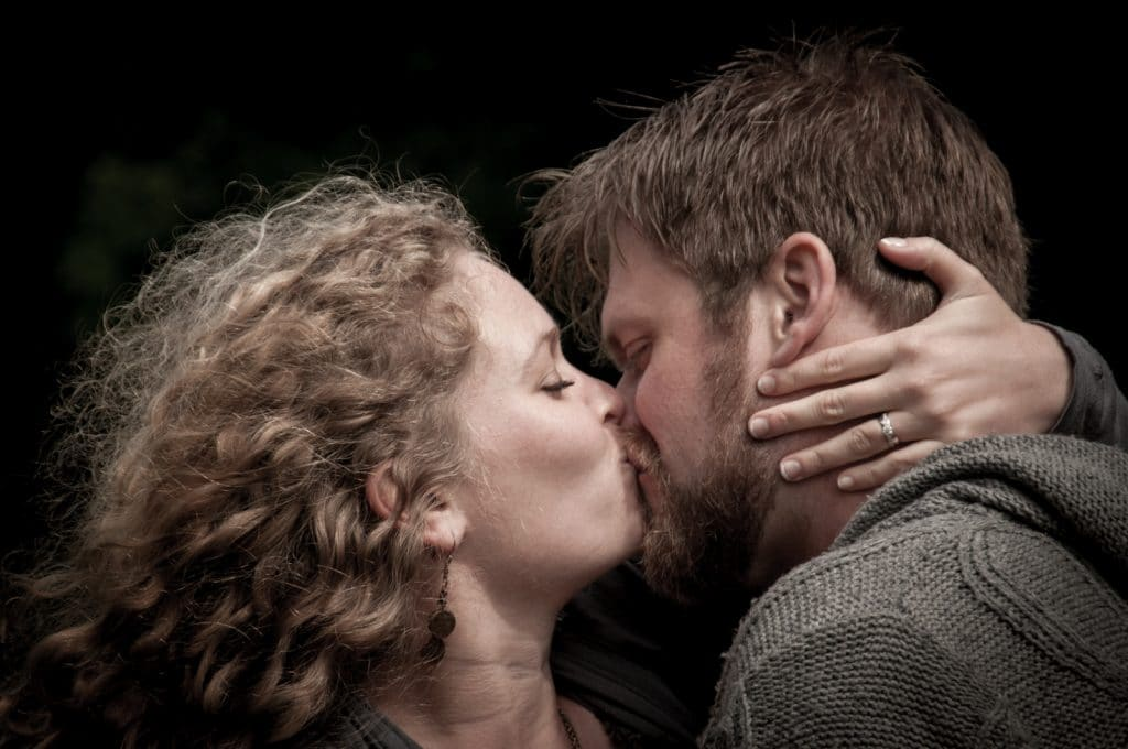 "Matt & Rachel sneak a smooch during an ""Save the Day"" photoshoot in Bruges Belgium. Photo by Photo Tour Brugge."